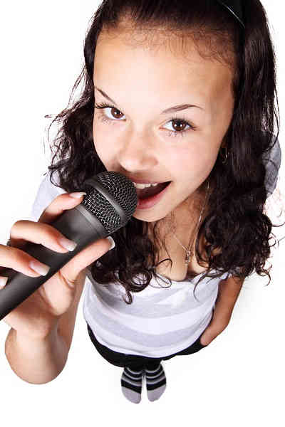 Ameri-Sing Karaoke - Woman Singing Into Microphone