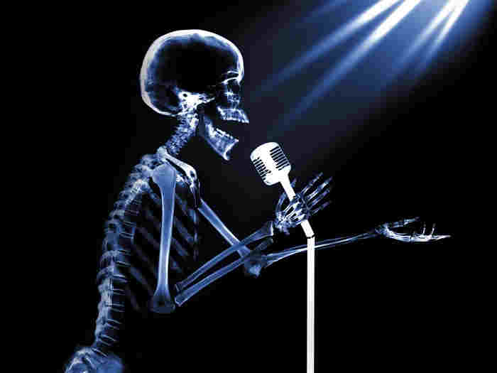 Independent Karaoke Labels - karaoke directory - skeleton singing into microphone